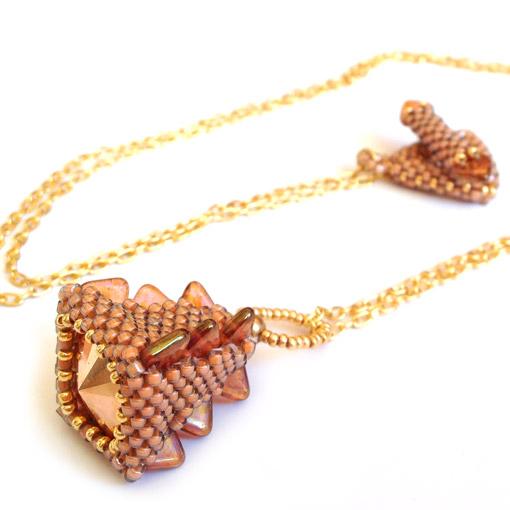Stegosaurus Drop Pendant - gold