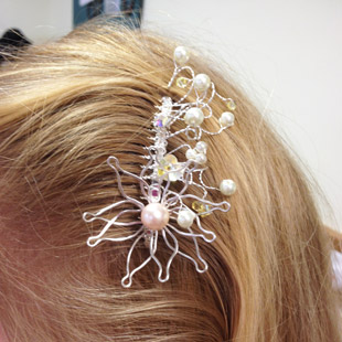Sue modelling her finished hair comb