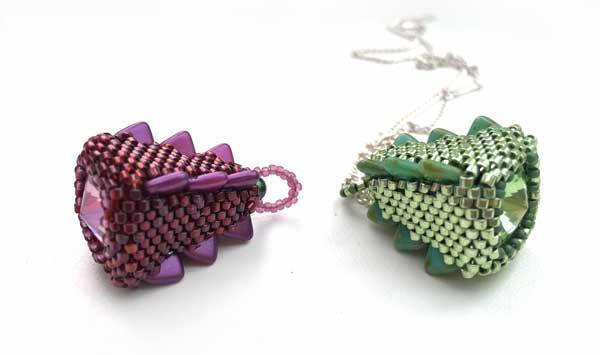 Helen and Maureen's Stegosaurus Pendants - green and mauve